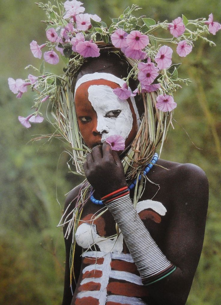 Documentary Photography, African Tribes, Ethiopia: Hans Silvester's 2006-2007 documentation of the Omo Valley's Surma and Mursi tribes and their body adornment via mineral paints and floral headpieces.