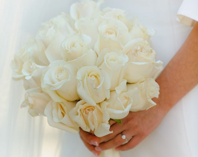 Here we selected a number of beautiful white rose wedding flowers for wedding bouquets and decorations to inspire anyone of you who's going to get married soon . . . :) Photo 1. A wedding bouquet w...