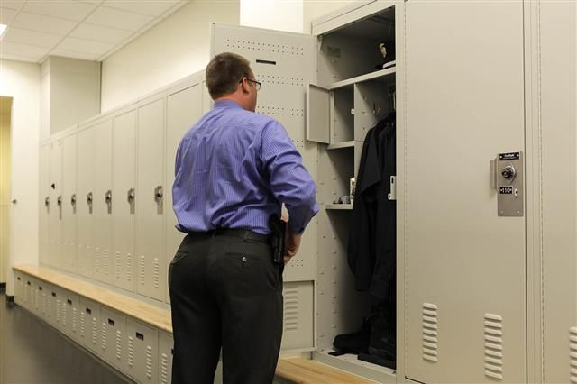 Ventilated gear lockers allow officer's belongings to remain dry while being stored. These law enforcement gear storage lockers are able to be customized for each officer's needs and wants in terms of personal storage | Spacesaver Corporation