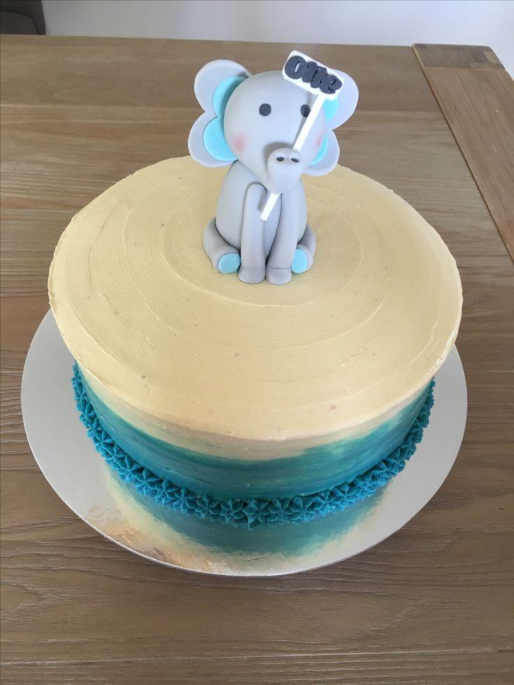 Buttercream paint effect First birthday cake