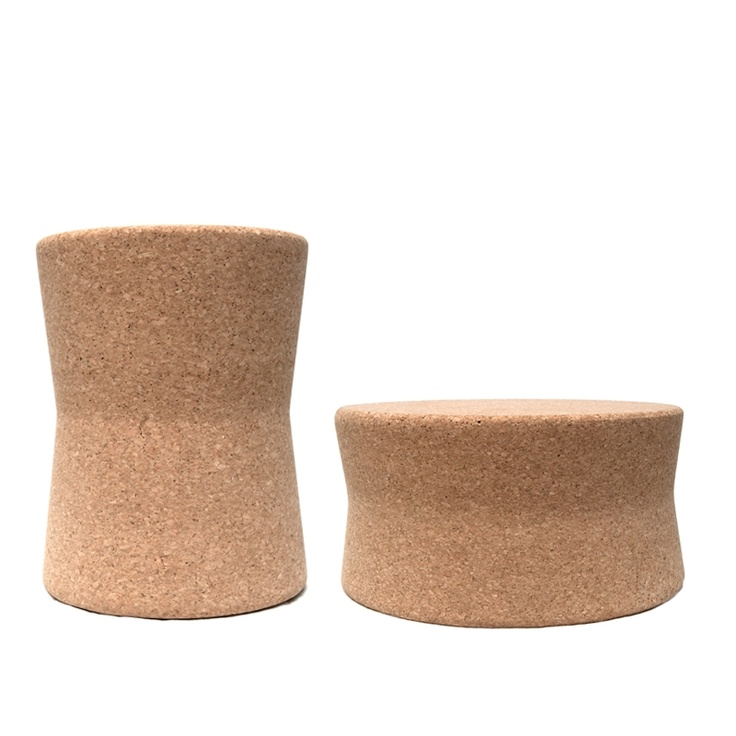 Cork side tables/stools perhaps with a calcutta marble or brass custom tray top?