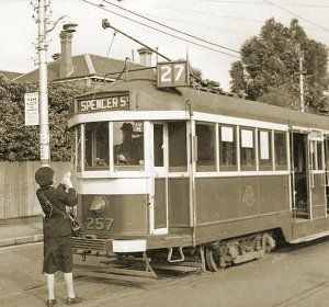 Conductress changing the trolley pole on W2 class tram no 257 at Hawthorn terminus in Power Street, circa 1943. Note the blackout precautions – white bars painted on the bumper and apron, and blackout hood on the headlight. Photograph courtesy State Library Victoria.