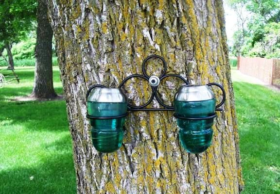 Sue Gerdes, of Flea2Fab, made a solar light fixture from two!
