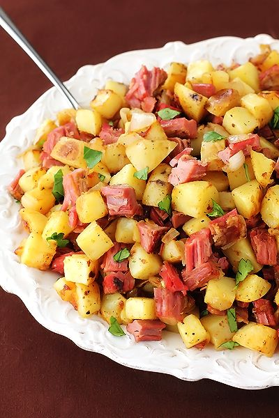 Corned Beef Hash Recipe  Ingredients:    * 3 cups small-diced potatoes (I used Yukon gold)      * 2-3 Tbsp. butter      * 1 medium white or yellow onion, diced      * 2 cloves garlic, minced      * 1 tsp. salt      * 1/2 tsp. freshly-cracked black pepper      * pinch of cayenne and dried thyme      * 2-3 cups shredded or diced (cooked) corned beef      * chopped fresh parsley, for garnish  -See method