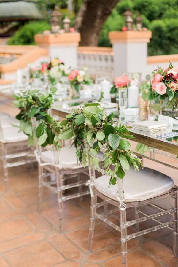Greenery infused wedding chair decor: Photography: Koman Photogrpahy - http://komanphotography.com/