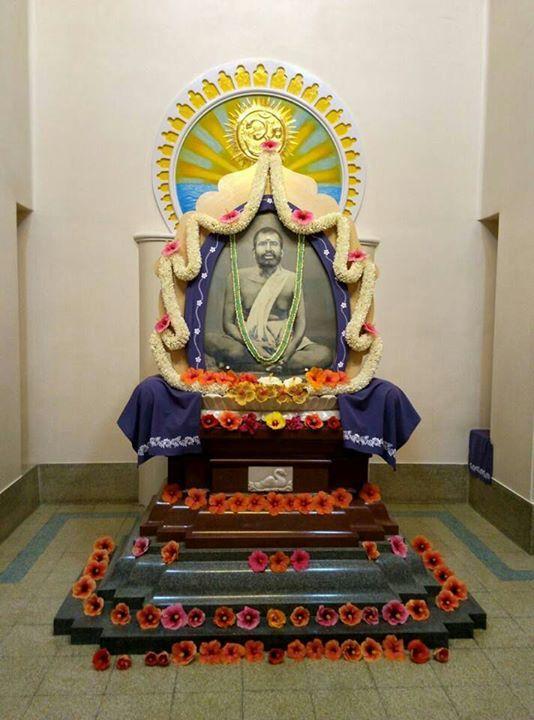 Sri Ramakrishna Ramakrishna Math Bengaluru. Rev. Yatishwaranandaji designed this special shrine. The bottom black granite stands for Tamas; the red for Rajas white lotus for Sattva. Above the three gunas lies Ishwara the Personal God - Sri Ramakrishna as a flame on top is the Impersonal represented by OM. - http://on.fb.me/1UyLydu