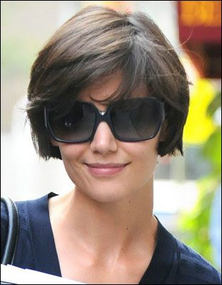 Very short bob cut with bangs. So carefree in a good way and summery looking