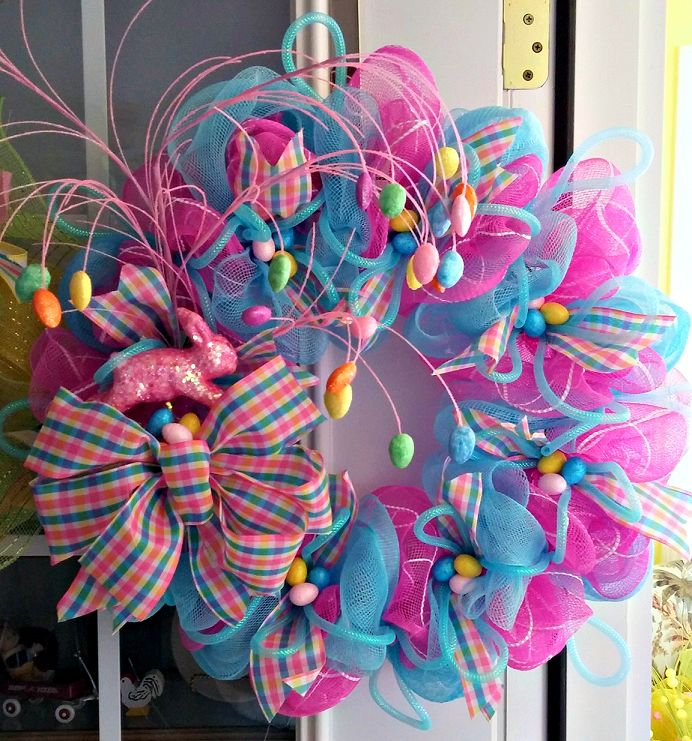 This beautiful Easter wreath was made by Terrie Dollar who sells her wreaths here. You will need… Wire wreath Pink and blue deco mesh Decorations (eggs, bunnies, bows, etc.) Hot glue gun Wire/pipe cleaners She said she just followed the directions in the