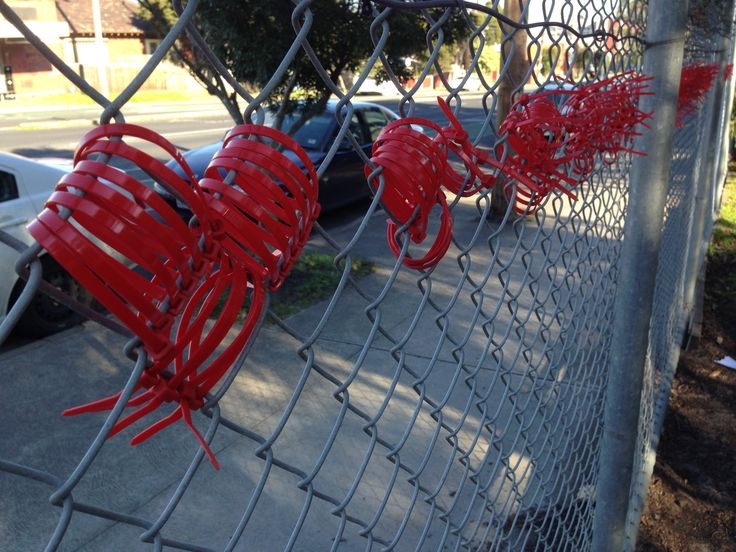 Red Cable Tie Love Hearts on school fence by Grade 3 and 4.