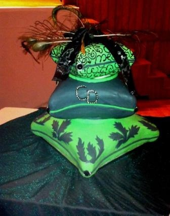 3 tier Pillow Wedding cake - Green and black fondant and royal icing decor. Feathers and material as toppers