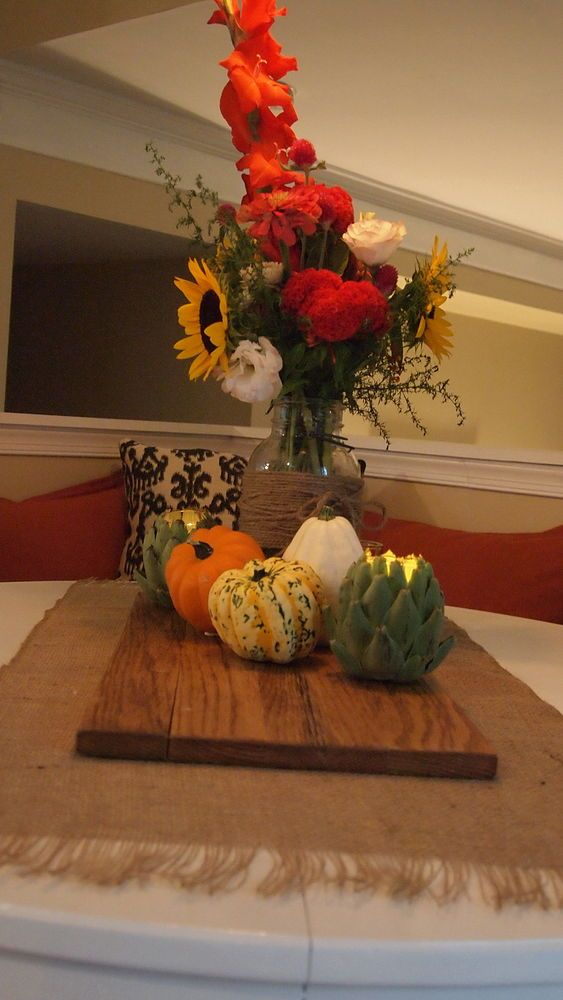 A simple Autumn Breakfast table - A simple autumn tablescape with a bouquet of fall wildflowers, seasonal squash, and artichoke candle holders. The artichoke ca….