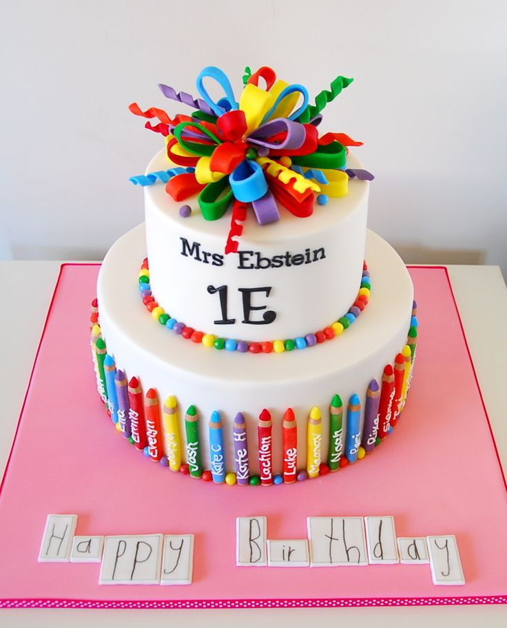 "Teacher birthday cake - A huge white chocolate mud cake for my daughter's Year 1 teacher.  All the children in the class had their name on a pencil and my 6 yr old daughter wrote ""Happy Birthday""."
