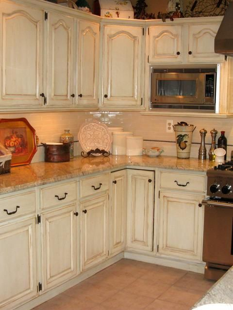hand painted and distressed kitchen cabinets  Similar to what we just did with our cabinets.  Love them!
