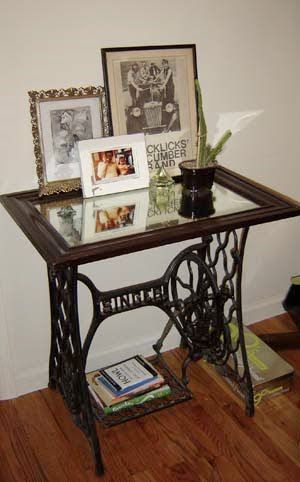 I love that she used a framed mirror as the top of the sewing machine stand. Great idea!
