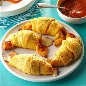 Pepperoni Roll-Ups Recipe -Here is a fast appetizer recipe that goes over well at my house. Each bite has gooey, melted cheese and real pizza flavor. Try serving them with pizza sauce for dipping. —Debra Purcell, Safford, Arizona
