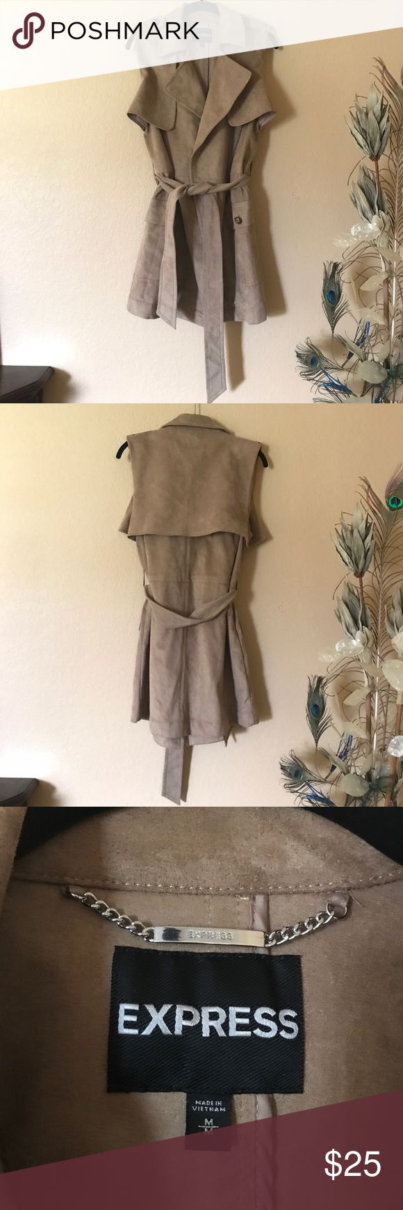 "EXPRESS vest Just in time for Fall! Faux tan suede belted vest will go great with a pair of skinny jeans and tall leather boots! Measures approx 30"" in length, and offers two big front pockets. Never worn. Express Jackets & Coats Vests"