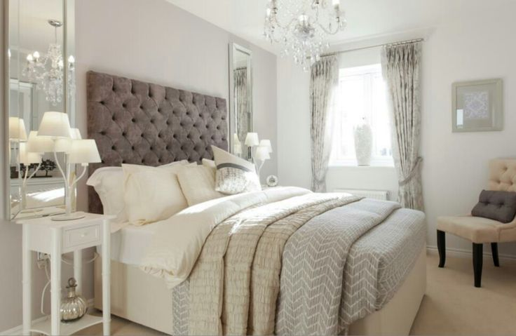 Interior Designed Guest Bedroom / Showroom by Taylor Wimpey Homes. Mink, silver & neutral tones, I adore the mirrors either side of the bed. Lovely use of Elephants Breath on the back wall.