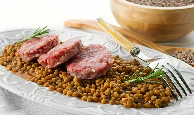 LENTILS = New Year's Food Tradition; A popular New Year's meal in Italy is Cotechino con Lenticchie (green lentils with sausage) because of the legume's greenish color and coin-like appearance. Deeper into the myth: When cooked, lentils plump with water, symbolizing growing wealth. Lentils are also considered good luck in Hungary, where they're preferred in a soup.