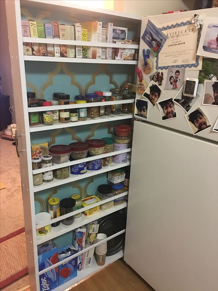 Spice rack diy next to refrigerator. made with wood and ply wood.