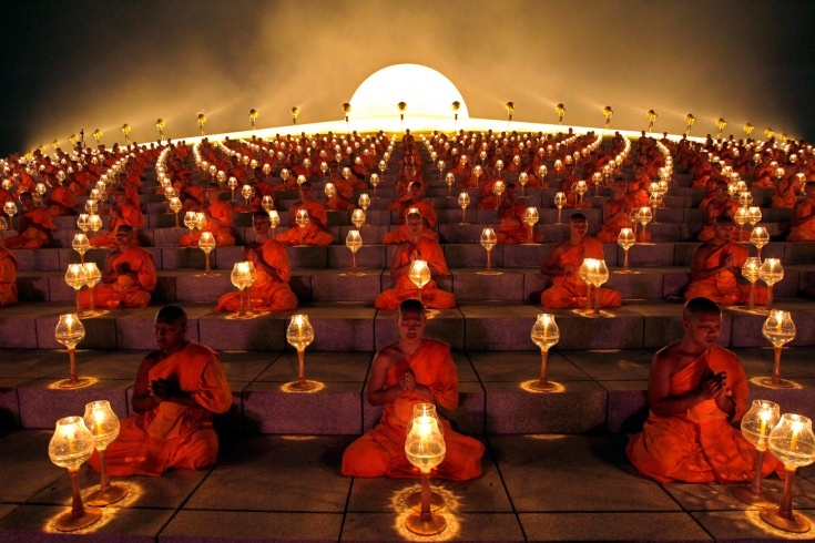 Thousands of Thai Buddhist monks chant during lantern lighting to celebrate Makha Bucha day at Dhammakaya Temple in Pathum Thani province, on the outskirts of Bangkok