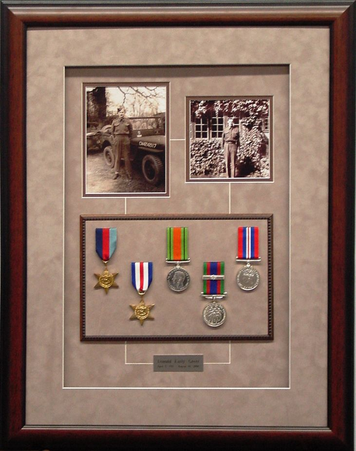 War Medals and photos in a shadowbox.  This one is a really nice design.  #military #frames #shadowbox