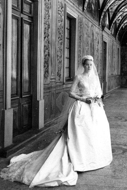 The dress that she wore for her April 19 1956 wedding to Prince Rainier was designed by Helen Rose and was made from 25 yards of silk taffeta, antique rose-point lace and pearls by three dozen seamstresses, who worked on it for six weeks. In exchange for terminating her contract with the film studio, Kelly granted MGM exclusive rights to film her wedding. The Wedding in Monaco was watched by an estimated 30 million television viewers. Photo By Rex Features