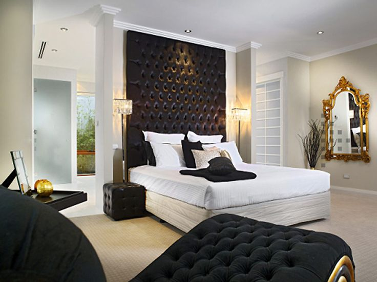 contemporary bedroom patterned headboard and ornate mirror