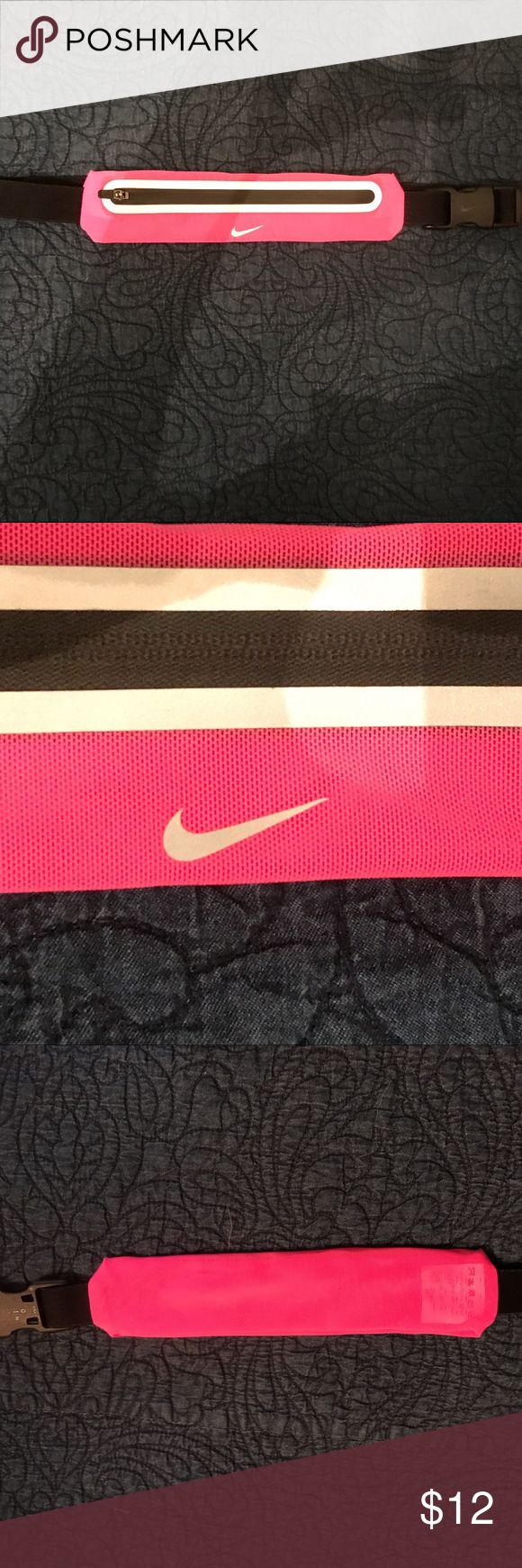 Nike Expandable Running Lean Waistpack Bright Pink and black. Great for exercising as well as travel (keeping money, credit cards, etc hidden). Small scuffs on back side shown in photo. Good condition.   Expandable stretch mesh fabrication Lightweight, breathable, and waterproof Convenient zip compartment  Secure storage for keys and other small items  Adjustable elastic belt  Fits securely and comfortably High contrast Swoosh, zipper pocket, and tabs Visibility and safety Nike Accessories…