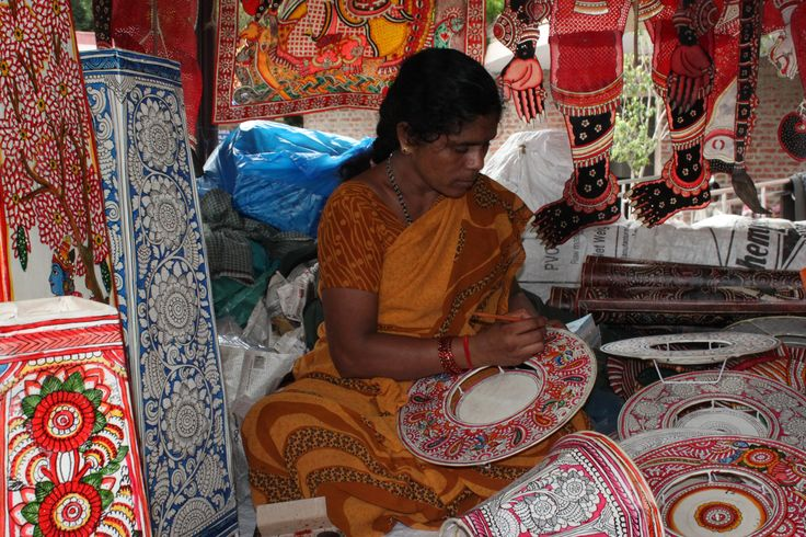 A lady working hard on the embroidery in Delhi Haat.
