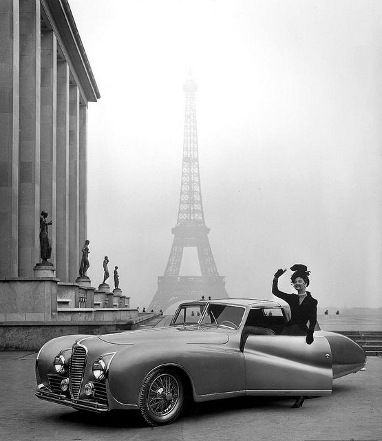 Model wearing Jacques Fath ensemble posing beside 1947 Delahaye automobile against background of the Eiffel Tower, photo by Tony Linck, 1947