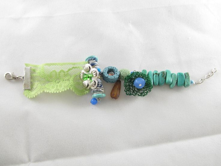 Handmade lace bracelet (1 pc)  Made with handmade silk fiber bead, handmade wire motif, lace, semiprecious stones and glass beads.