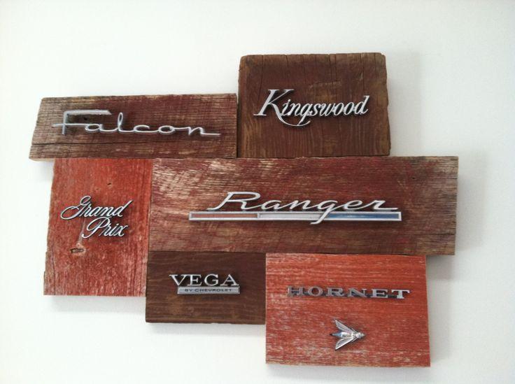 Reclaimed wood art adorned with vintage car/truck emblems.. $179.00, via Etsy.