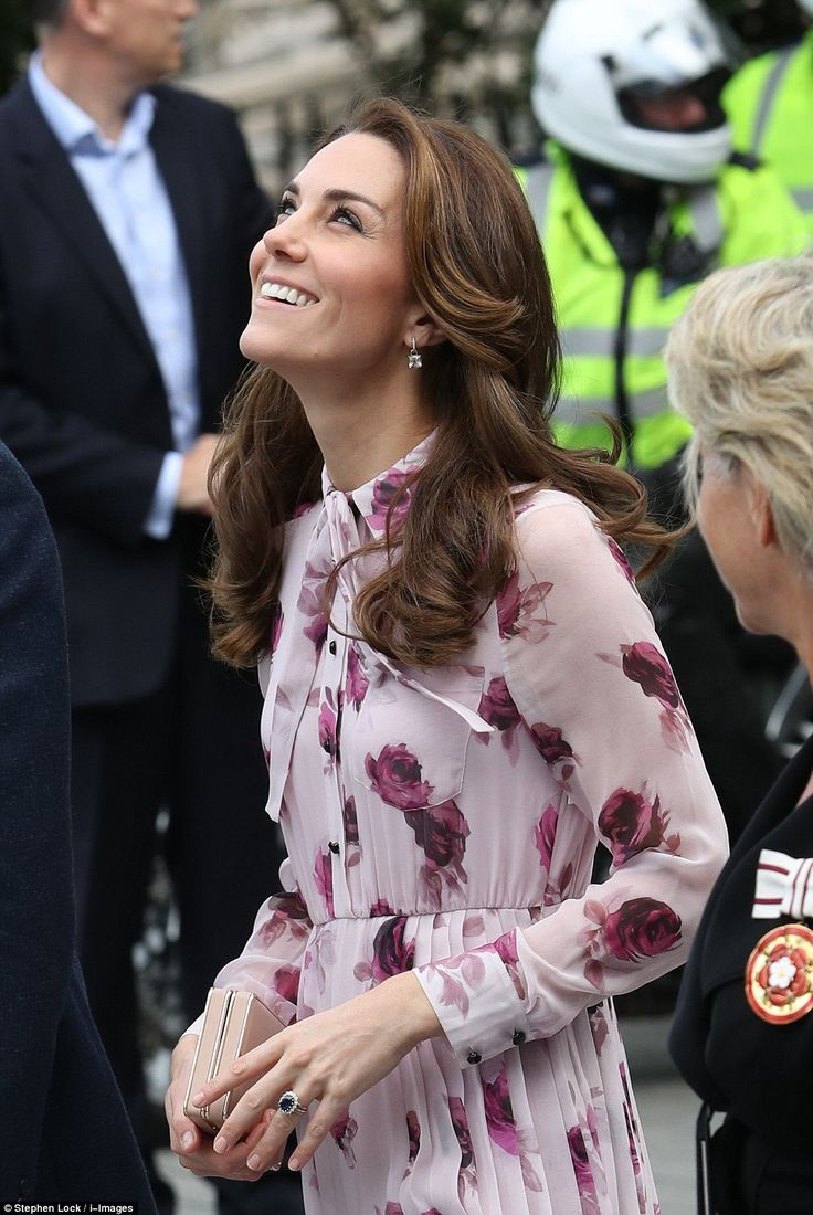 The Duchess glances up at The London Eye, which will later be lit up in purple to mark Wor...