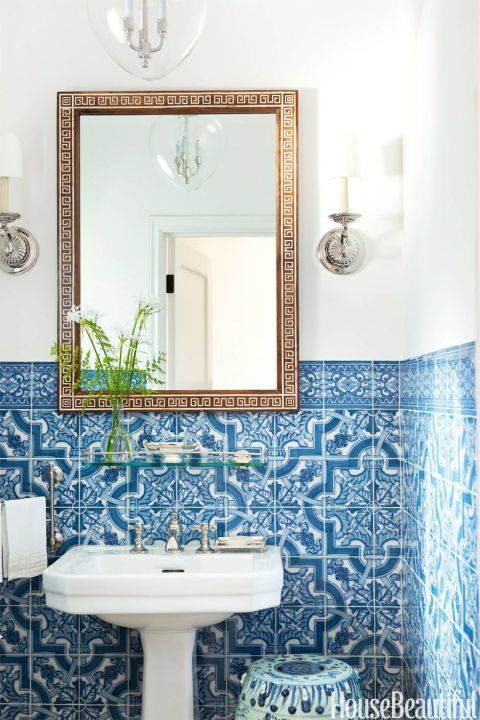 ARTISAN TOUCH – Hand-painted Portuguese tiles bring drama to the powder room of Mark D. Sikes's Hollywood house. Click through for more bathroom tile ideas.