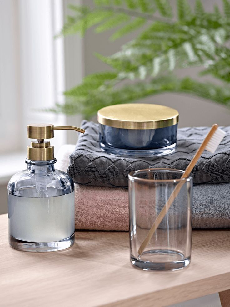 Crafted from coloured glass with brass accents our for Charcoal bathroom accessories