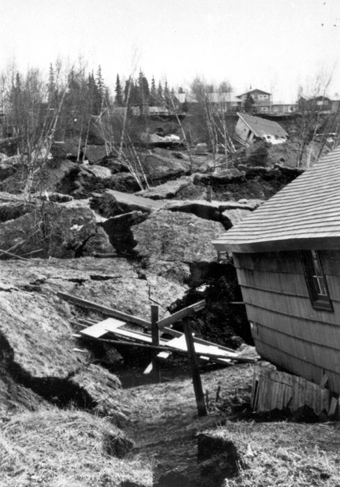 Alaska Earthquake March 27, 1964. Damage to houses from landslides in Turnagain Heights in Anchorage. Photo by R.A. Page. Pages 24-25 , Earthquake Information Bulletin, v.12, no.1.