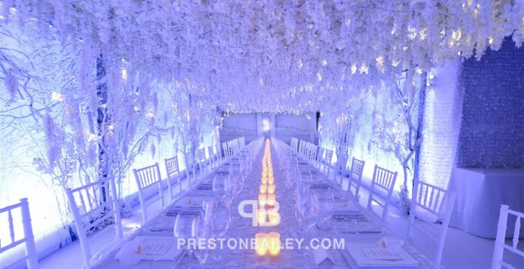 birthday party branches candles ceiling treatment draping entertaining floral screen lighting & projection table setting wisteria color|blue color|white color|yellow