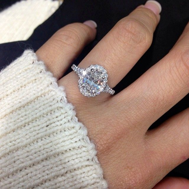 Custom Designed Oval Halo with Split Shank in Platinum. 1.21 Carat GIA Oval Brilliant Center Stone. Diamonds on this engagement ring weighs a total of 1.89 carats!