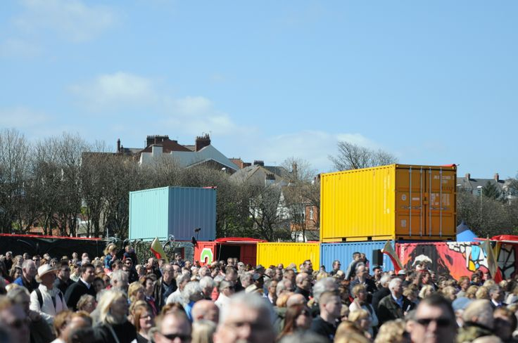 Crowds gather inside the giant cross formation made from shipping containers at Bents Park, South Tyneside for BBC's Great North Passion.