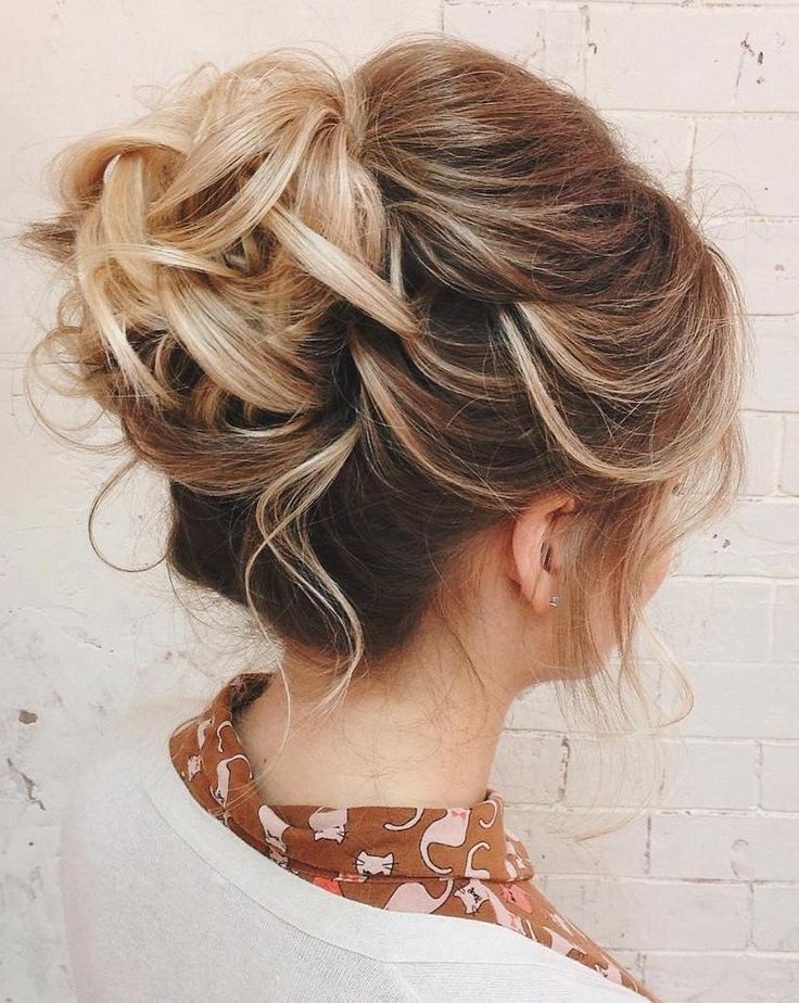 #4: Wavy Low Bun When you wear your hair down, it always looks like you have thicker strands if it is curled as opposed to blow dried straight. The same rule ap