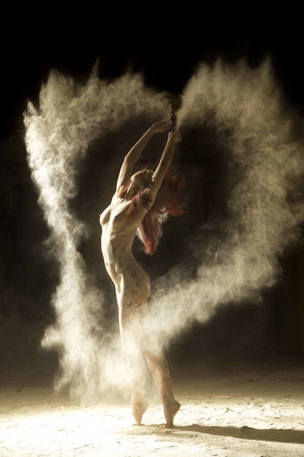 """French photographer Ludovic Florent recently released this series, titled Poussiére D'étoiles, on his personal website. The title, which translates to """"Stardust,"""" features a number of nude dancers highlighting their bodies' movements with free-falling white powder.The powder was...flour, used as a prop to emphasize the motions made by the dancers' techniques....The stunning women are viewed as both powerful and expressive beings. Take a look at some of the beautiful images (NSFW)."""