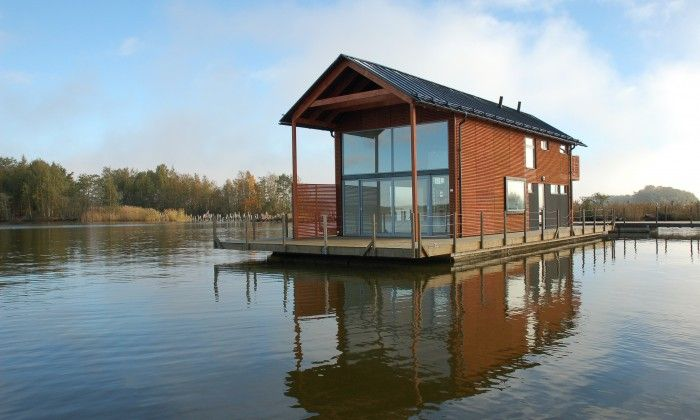 A modern Finnish mökki that floats and can be moved around lakes ...