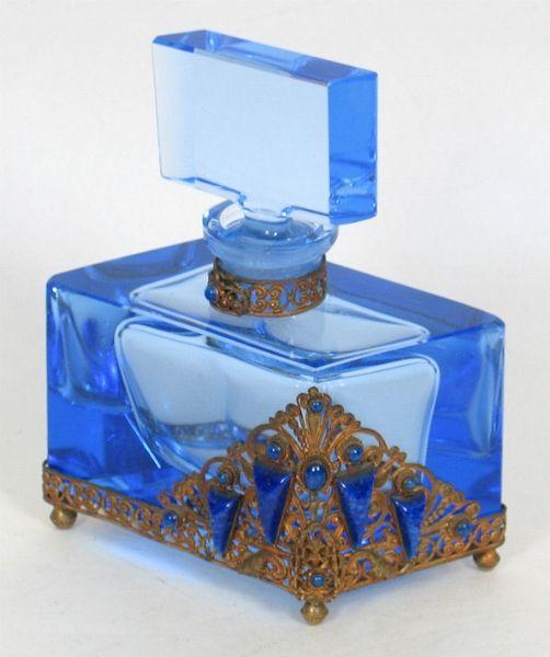 Ornamental blue perfume bottle