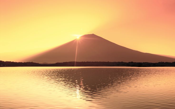Climb Mount Fuji in time to watch the sunrise.