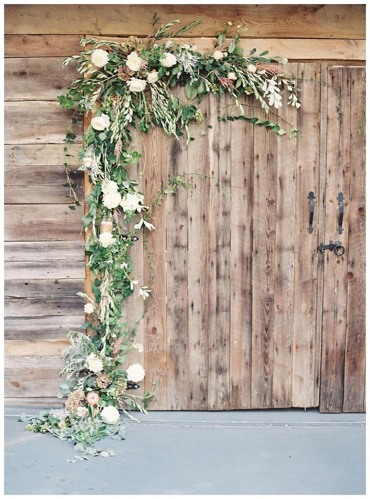Barn doors with floral garland. Florals by Nectar. Image by Allison Kuhn Photography. Styling by Love and Honey, Tina Doody