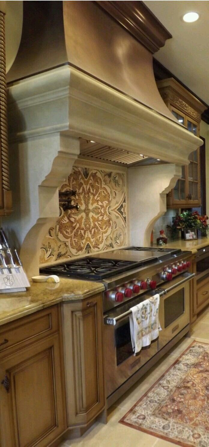 French-Country kitchen, classic, beautiful stove backsplash and copper hood.