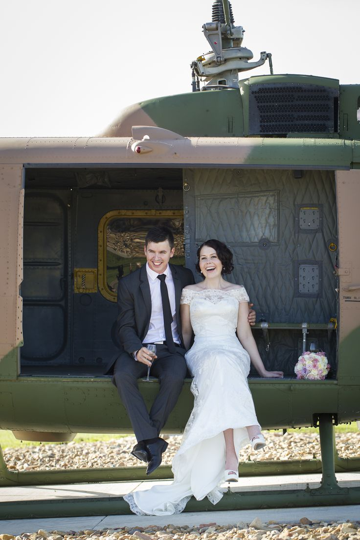 Bride and groom with helicopter in Townsville, North Queensland