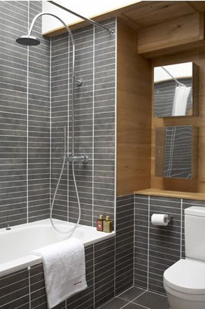 gorgeous contrast of the grey tile and the wood.  Stunning bathroom...