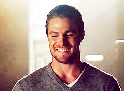 Distraction. Distraction. Distraction. Stephen Amell as Oliver Queen in Arrow. My god, that smile. | Gif source: queensverdant