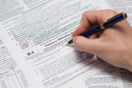 Filling out a W-4 Form.